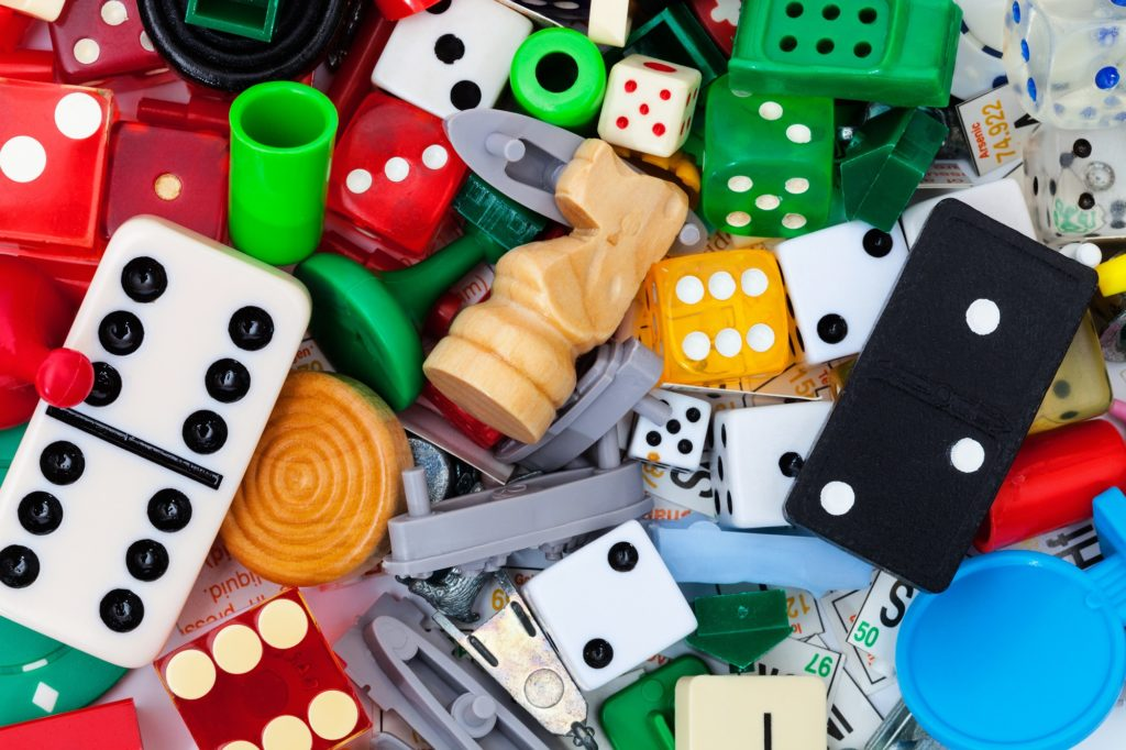 Dice and game pieces for creating an original board game
