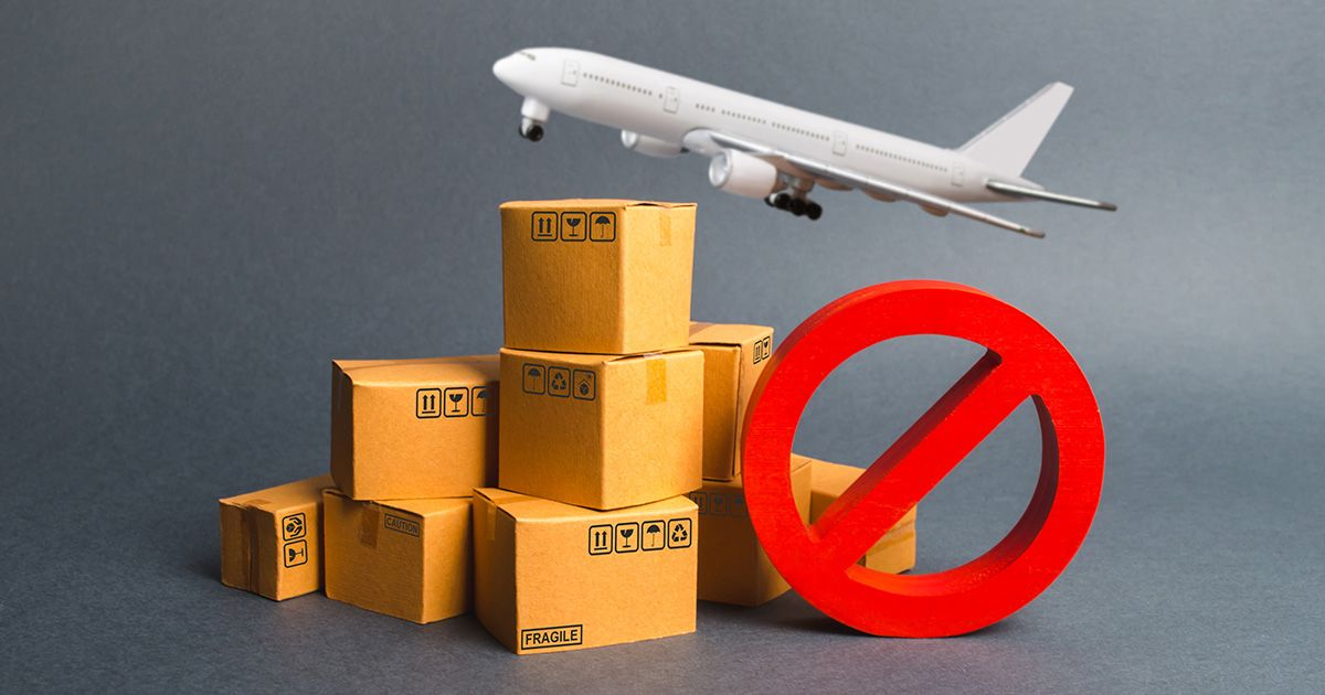 plane flying over boxes with red