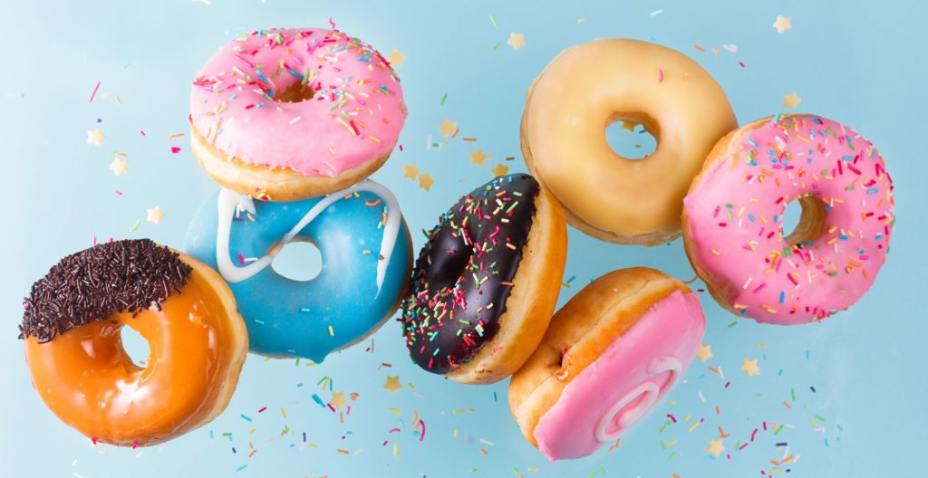 Assortment of colorful donuts floating in the air