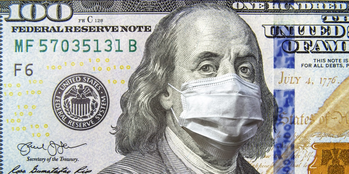 One hundred dollar bill with COVID mask