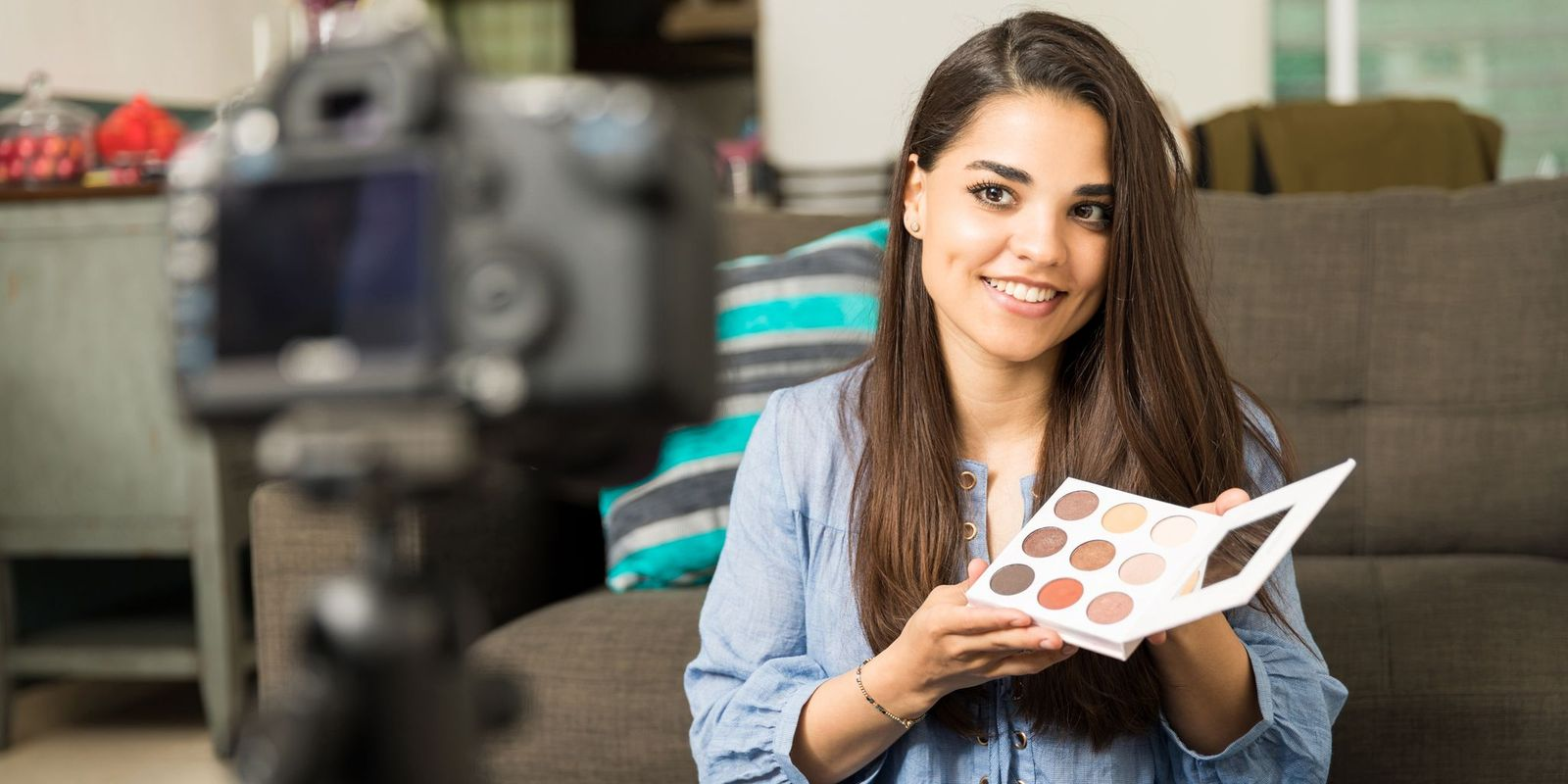 woman presenting beauty products to video camera