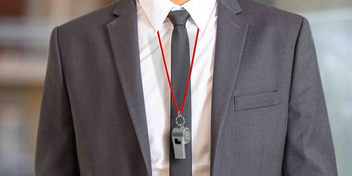 Businessman with whistle around neck