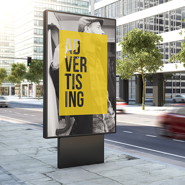 billboard on sidewalk with yellow 'advertising' poster