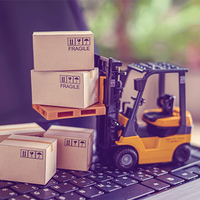 toy forklift with miniature boxes on a laptop keyboard