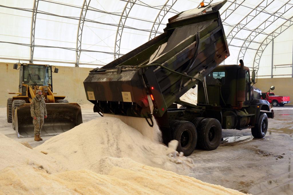 dump truck dumping sand