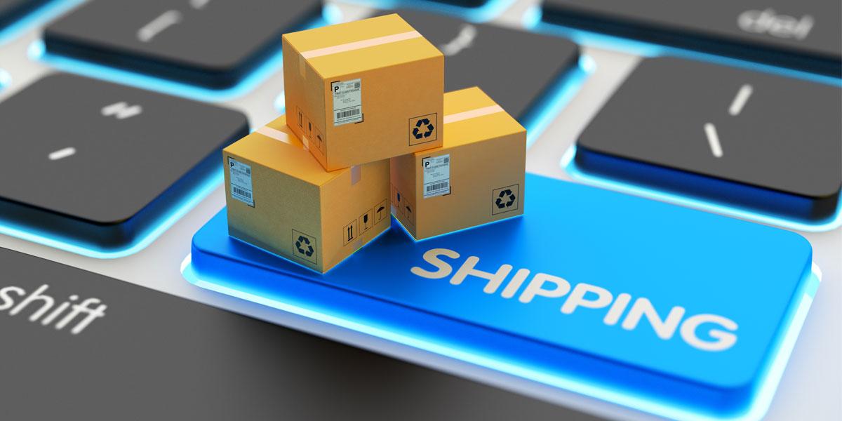 Shipping logistics boxes on laptop keyboard